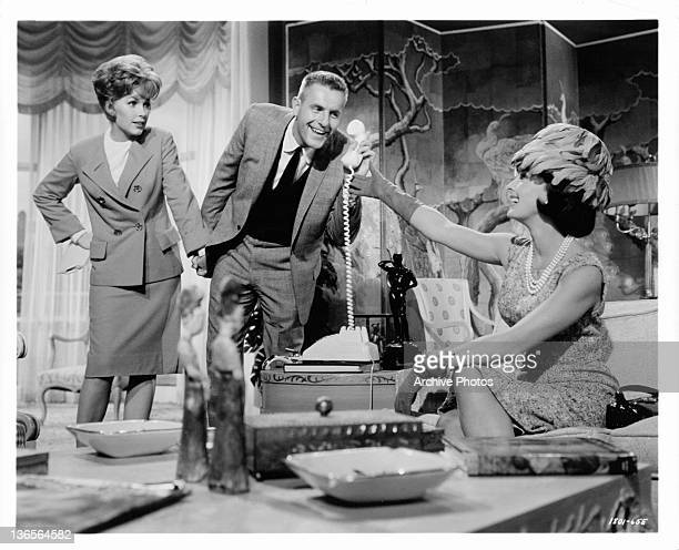 Stella Stevens and Jerry Van Dyke break the news of their engagement to Dina Merrill in a scene from the film 'The Courtship Of Eddie's Father' 1963
