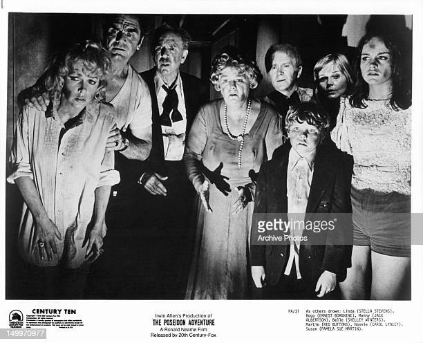 Stella Stevens Ernest Borgnine Jack Albertson Shelley Winters Red Buttons Carol Lynley Pamela Sue Martin gather together in fear in a scene from the...