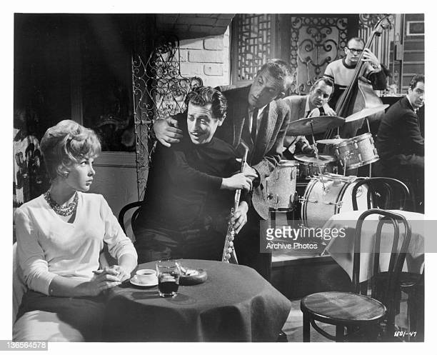Stella Stevens looks uncomfortable under the intense admiration of Vito Scotti while Jerry Van Dyke tries to act like a decoy in a scene from the...