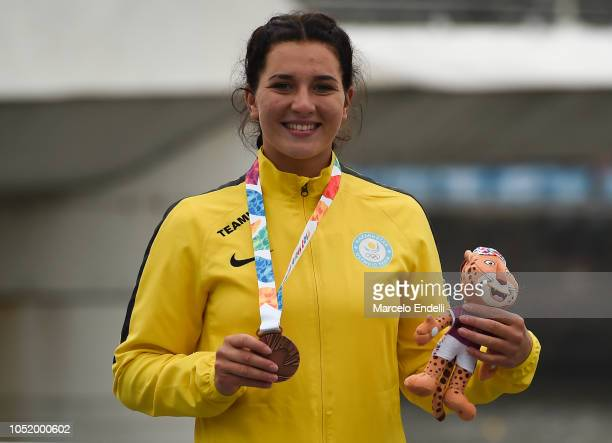 Stella Sukhanova of Kazakhstan poses with her Bronze medal after the Women's Kayak Head to Head Sprint during day 6 of Buenos Aires Youth Olympic...