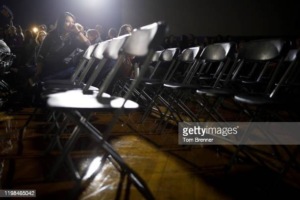 Stella Templo watches caucus results come in from a television screen during a watch party for Democratic presidential candidate former South Bend...