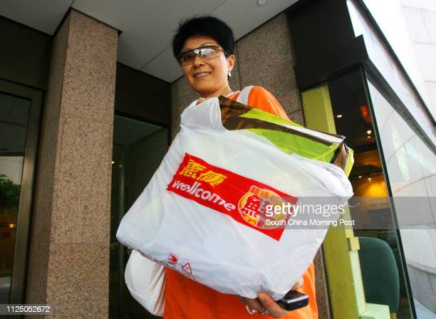 Stella Tsui shows her 'I'm NOT a plastic bag' bag by Anya Hindmarch which she has bought and today collect it from Wellcome supermarket at The Forum...