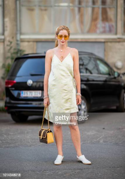 Stella von Senger wearing dress, Fendi bag is seen outside Ganni during the Copenhagen Fashion Week Spring/Summer 2019 on August 9, 2018 in...
