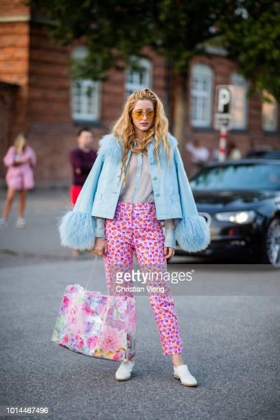 Stella von Senger wearing pink pants with print blue jacket Saks Potts bag is seen outside Saks Potts during the Copenhagen Fashion Week...