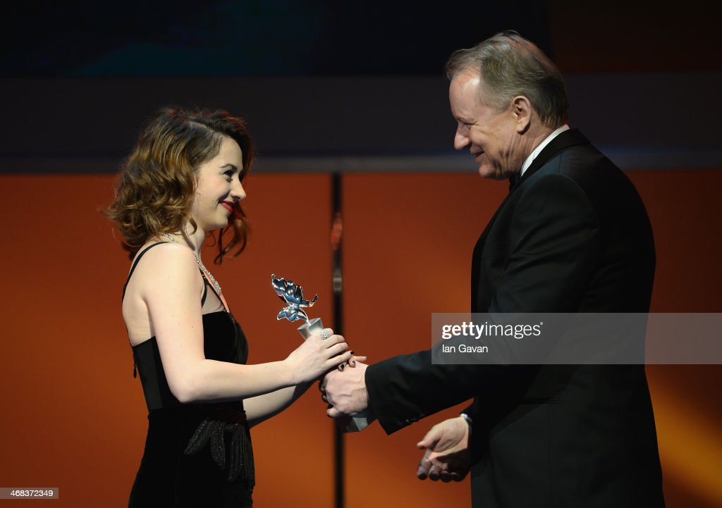 Stellan Skarsgard and Cosmina Stratan on stage at the Shooting Stars stage presentation during the 64th Berlinale International Film Festival at the Berlinale Palast on February 10, 2014 in Berlin, Germany.