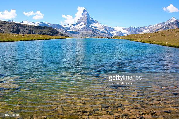 Stellisee and the Matterhorn with banner clouds