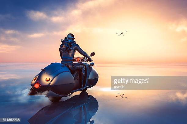 Stempunk biker driving through frozen fantasy landscape