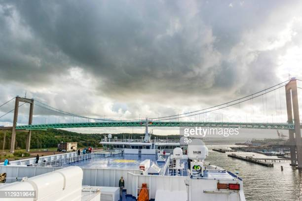 stena lines ferry passing the älvsborgsbron in the port of gothenburg, sweden - dalsland stock photos and pictures