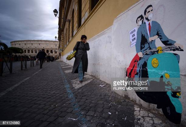 A stencil depicting a scene of the 1953 movie 'Roman Holiday' with US actors Gregory Peck and Audrey Hepburn wearing masks and holding a poster...