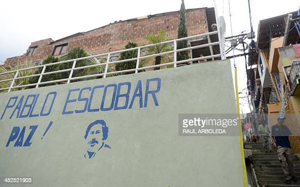 A stencil depicting late Colombian drug lord Pablo Escobar is seen at the Pablo Escobar neighborhood on November 24 2013 in Medellin Antioquia...