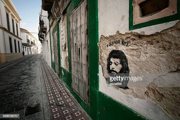 stencil street art in the streets of tarifa - tarifa stock photos and pictures
