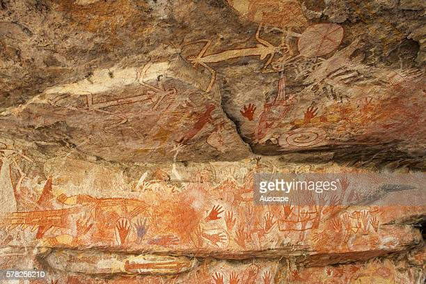 Stenciled hands and paintings in the Main Art Site Rock art at Mount Borradaile dates back many thousands of years Mount Borradaile Awunbarna Arnhem...
