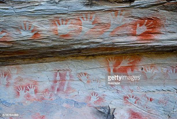 Stenciled hands at the Tombs a sacred area used as a burial site by the Aboriginal inhabitants of the region Vandals and grave robbers had desecrated...