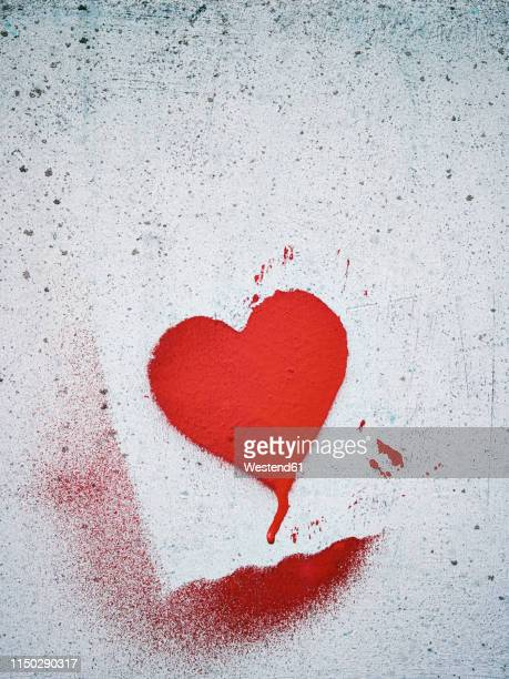 stenciled heart on a wall - stencil stock pictures, royalty-free photos & images