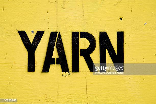 Stenciled lettering on sign reading 'yarn