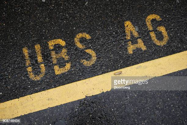Stenciled UBS AG lettering sits on a parking space outside the UBS Group AG headquarters in Zurich Switzerland on Monday Jan 22 2018 A UBS loan...