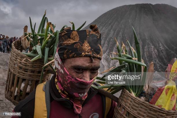 STenggerese worshippers carries vegetables as offerings during the Yadnya Kasada Festival at crater of Mount Bromo on July 18 2019 in Probolinggo...