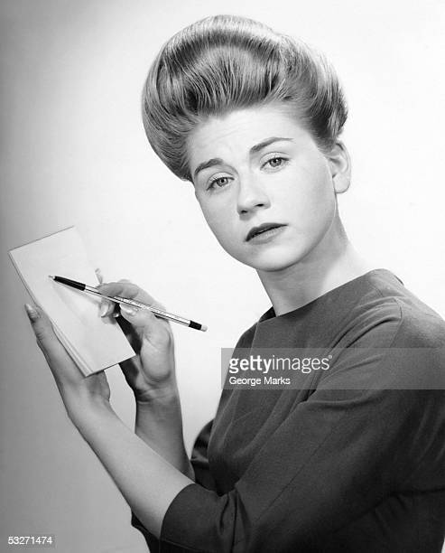 stenographer with pencil and pad - big hair stock pictures, royalty-free photos & images
