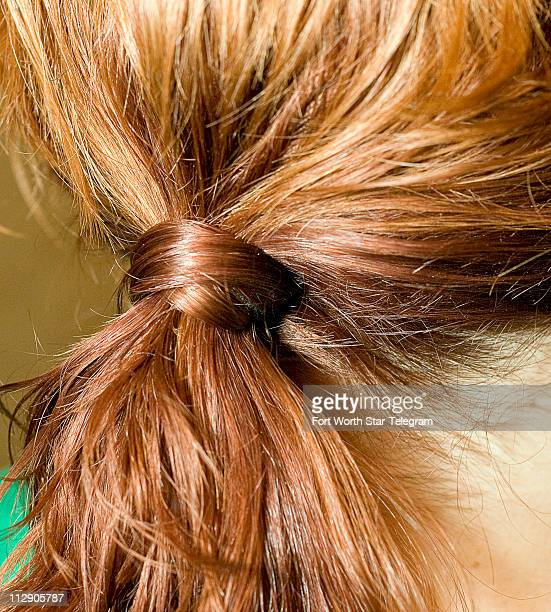 Gather in a low loose ponytail at the nape of the neck and secure with a hair band Pull hair gently at the crown Stylist Tricia Evans says keeping...