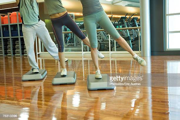 Step aerobics class, low section