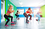 women doing step aerobics