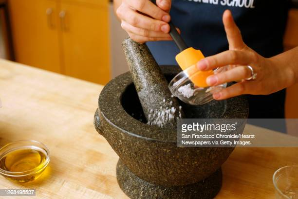 Step by step of making pistou. Put the garlic and salt in a mortar and crush them together with a pestle to make a paste.Photo by Craig Lee / The...