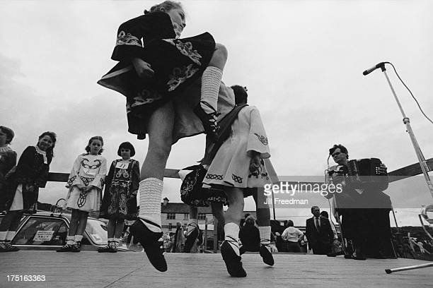 Step dancing girls perform on stage to a small audience Ireland 1988