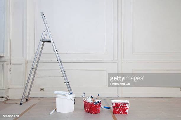 step ladder paint roller and brush and paint can - step ladder stock photos and pictures