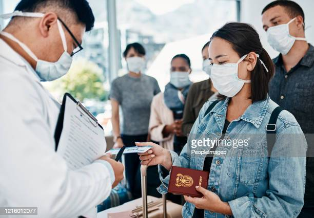 step up the security measures and stop the spread - coronavirus airport stock pictures, royalty-free photos & images