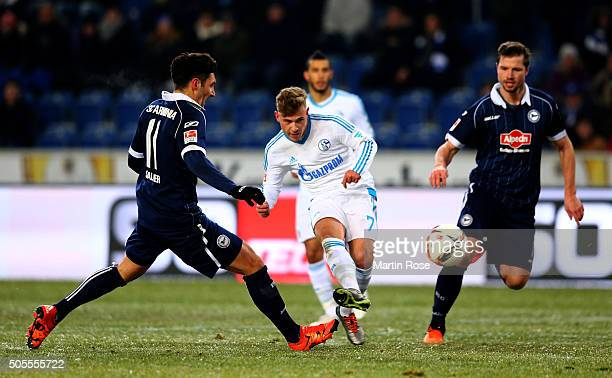 Stepahn Salger of Bielefeld and Max Meyer of Schalke battle for the ball during the friendly match between Arminia Bielefeld and Schalke 04 at...