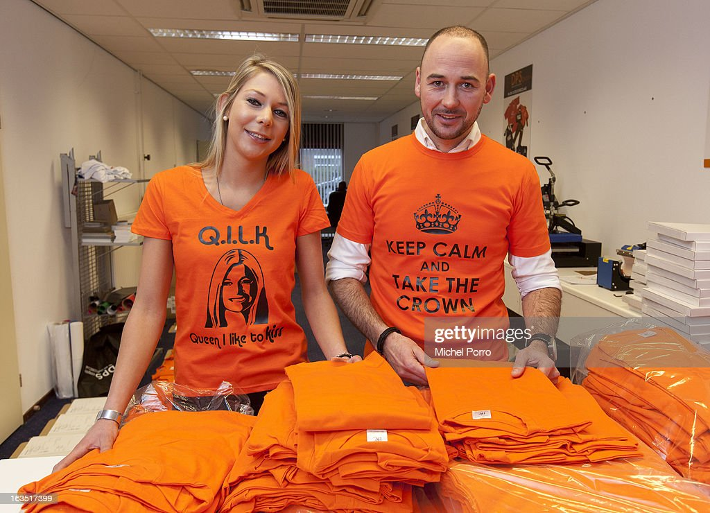 Stepanie van Oosterbosch and Wesley Koevoet wear t-shirts, designed by DPS Company, displaying prints relating to the upcoming Coronation Of Prince Willem Alexander on March 11, 2013 in Roosendaal, Netherlands.