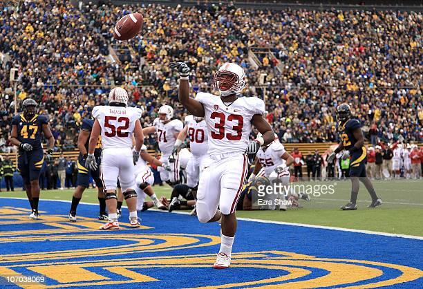 Stepfan Taylor of the Stanford Cardinal tosses the ball into the air after he ran in for a touchdown against the California Golden Bears at...