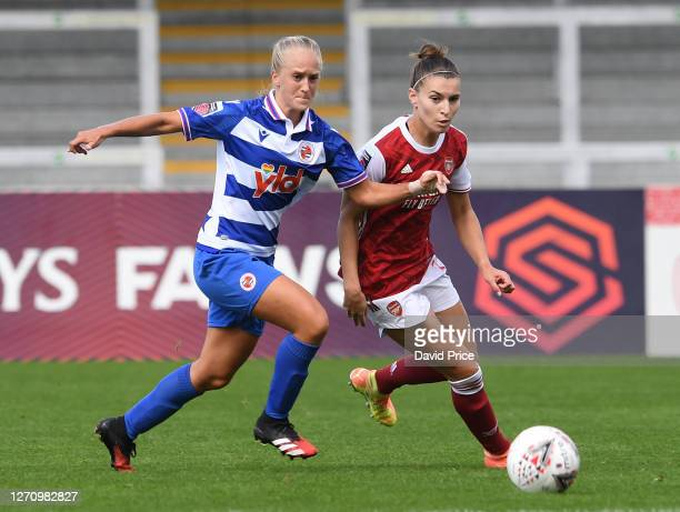 Steph Catley of Arsenal is challenged by Amelie Eikeland of Reading during the match between Arsenal Women and Reading Women at Meadow Park on...