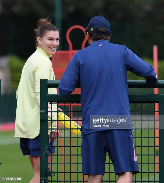 Steph Catley of Arsenal with Arsenal Womens Manager Joe Montemurro during the Arsenal Women training session at Arsenal Academy on July 29 2020 in...