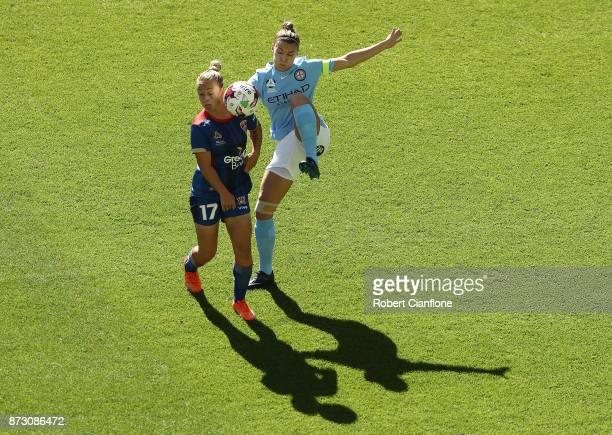 Steph Catley of Melbourne City challenges Jenna Kingsley of the Jets during the round three WLeague match between Melbourne City and the Newcastle...