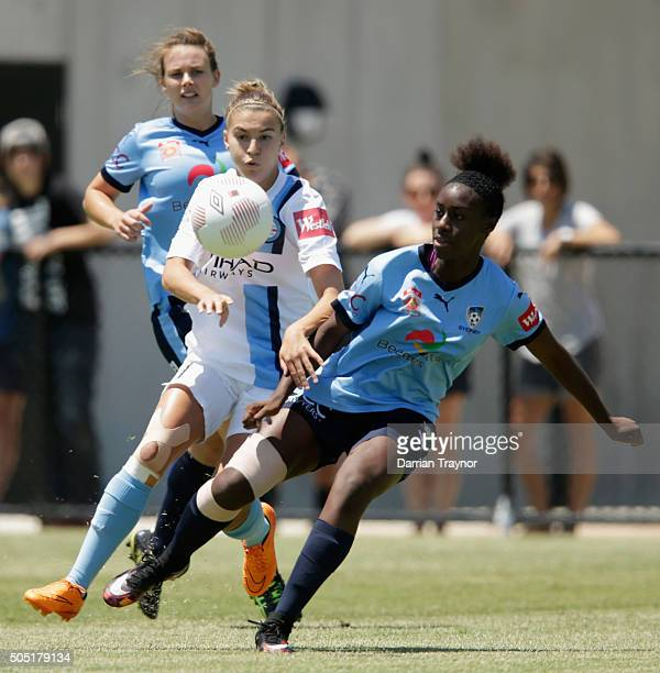 Steph Catley of Melbourne City challenges Princess Ibini of Sydney FC during the round 14 WLeague match between Melbourne City FC and Sydney FC at...