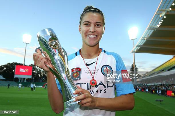 Steph Catley of Melbourne City poses with the trophy after winning the 2017 WLeague Grand Final match between the Perth Glory and Melbourne City FC...
