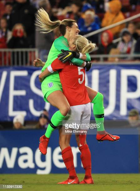 Steph Houghton and Carly Telford of England celebrate victory after the 2019 SheBelieves Cup match between England and Japan at Raymond James Stadium...