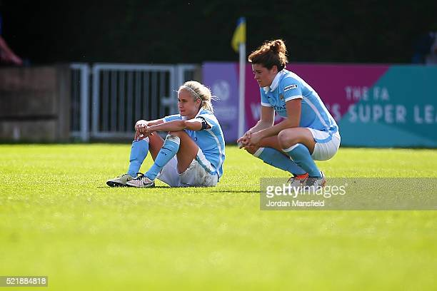 Steph Houghton and Jen Beattie of Manchester City look dejected after their loss in the SSE Women's FA Cup Semifinal match between Chelsea Ladies FC...