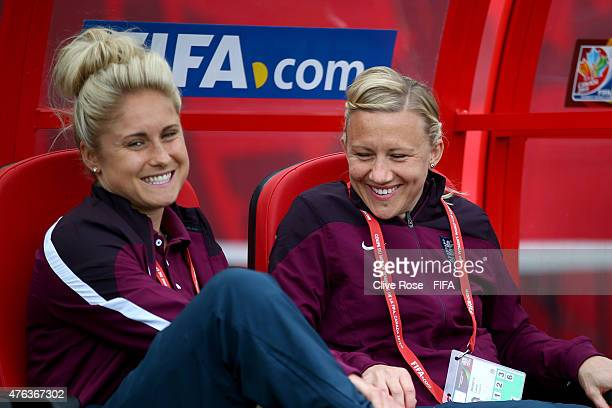Steph Houghton and Laura Bassett of England talk during a training session at the Moncton Stadium on June 8 2015 in Moncton Canada