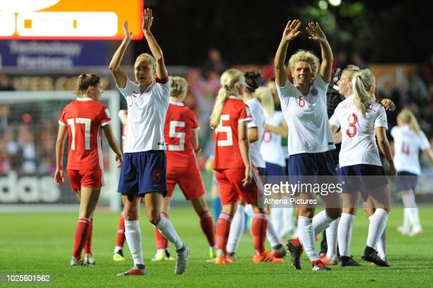 Steph Houghton and Millie Bright of England Women applauds the fans at the final whistle during the FIFA Women's World Cup Qualifier match between...