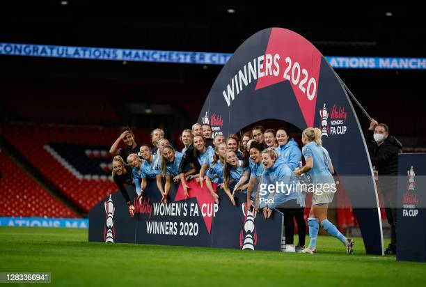 Steph Houghton, Captain of Manchester City prepares to lift the Vitality Women's FA Cup Trophy following her team's victory in the Vitality Women's...