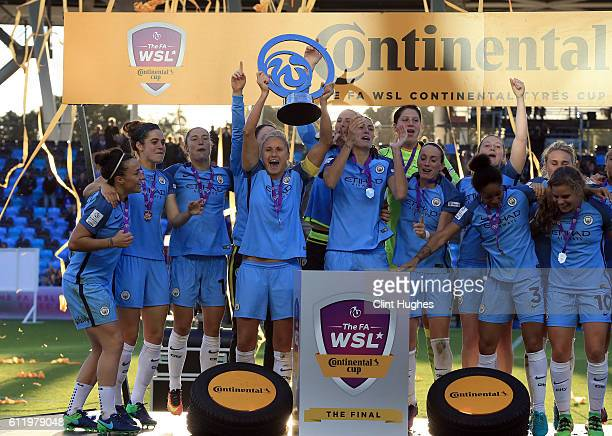 Steph Houghton captain of Manchester City Women lifts the trophy and celebrates with her teammates after winning the Continental Cup Final between...