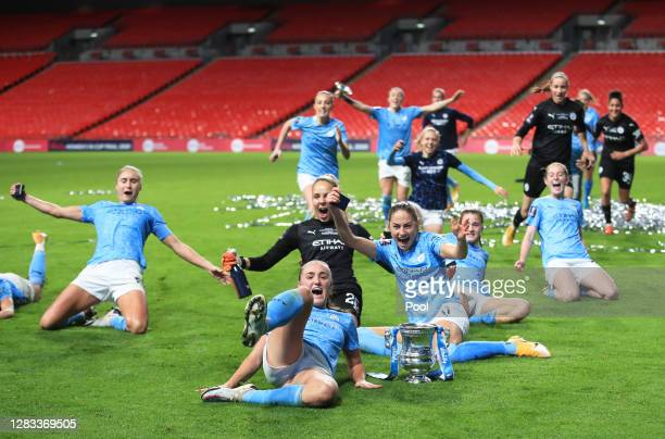 Steph Houghton, Georgia Stanway, Ellie Roebuck, and Janine Beckie of Manchester City celebrate with the Vitality Women's FA Cup Trophy following...