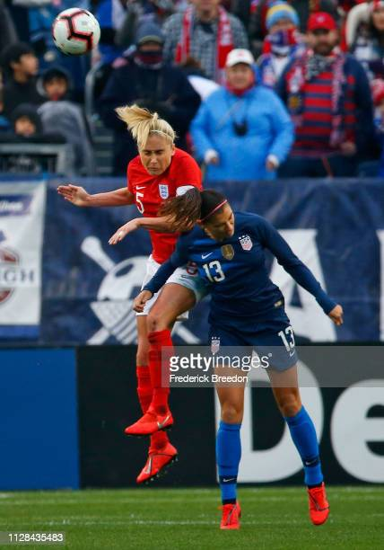 Steph Houghton of England and Alex Morgan of the USA jump for a ball during the second half of the 2019 SheBelieves Cup match between USA and England...