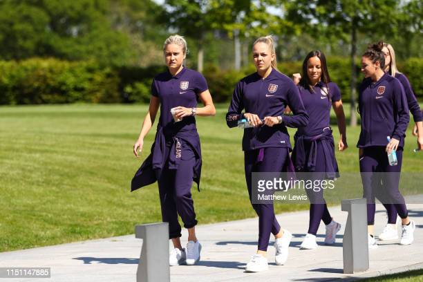 Steph Houghton of England and Ellie Roebuck of England arrive for a training session at St Georges Park on May 23 2019 in BurtonuponTrent England