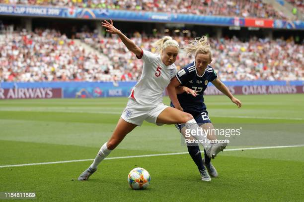 Steph Houghton of England battles for possession with Erin Cuthbert of Scotland during the 2019 FIFA Women's World Cup France group D match between...
