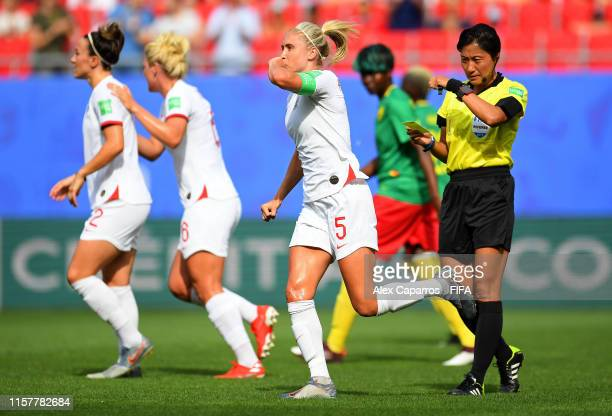 Steph Houghton of England celebrates after scoring her team's first goal during the 2019 FIFA Women's World Cup France Round Of 16 match between...