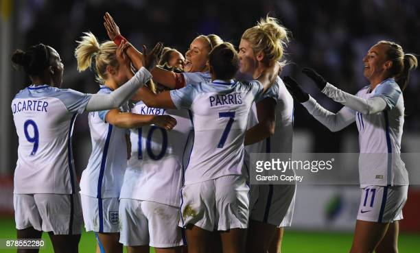 Steph Houghton of England celebrates as she scores their first goal with team mates during the FIFA Women's World Cup Qualifier between England and...