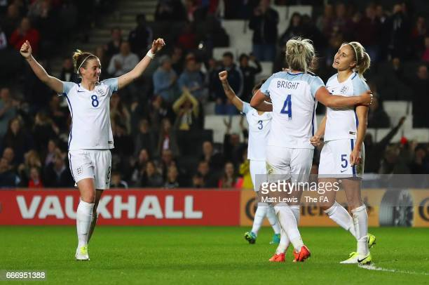 Steph Houghton of England celebrates as she scores their third goal with team mates during the Women's International Friendly match between England...